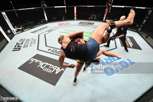 In this handout image provided by UFC, : Jessica Andrade of Brazil takes down Katlyn Chookagian in their women's flyweight bout during the UFC Fight...
