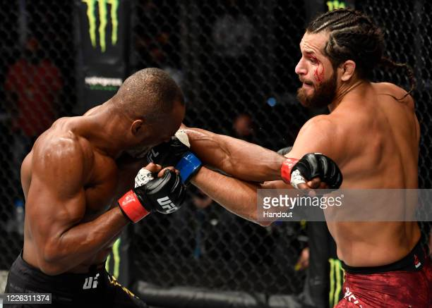 In this handout image provided by UFC, Jorge Masvidal punches Kamaru Usman of Nigeria in their UFC welterweight championship fight during the UFC 251...