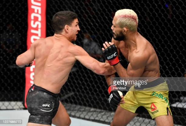 In this handout image provided by UFC Joseph Benavidez punches Deiveson Figueiredo of Brazil in their UFC flyweight championship bout during the UFC...