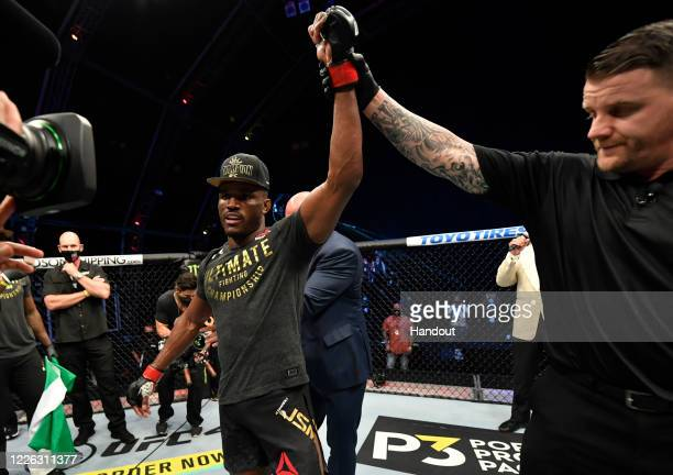 In this handout image provided by UFC, Kamaru Usman of Nigeria celebrates after his victory over Jorge Masvidal in their UFC welterweight...