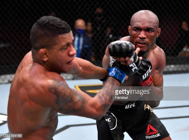 In this handout image provided by UFC, Kamaru Usman of Nigeria punches Gilbert Burns of Brazil in their UFC welterweight championship fight during...
