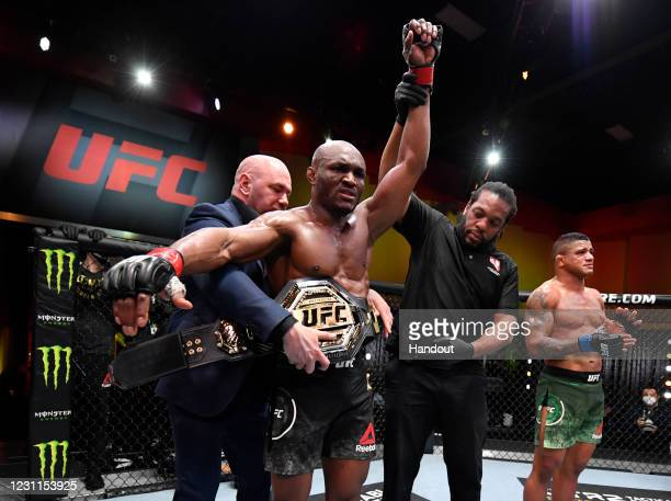 In this handout image provided by UFC, Kamaru Usman of Nigeria reacts after his victory over Gilbert Burns of Brazil in their UFC welterweight...