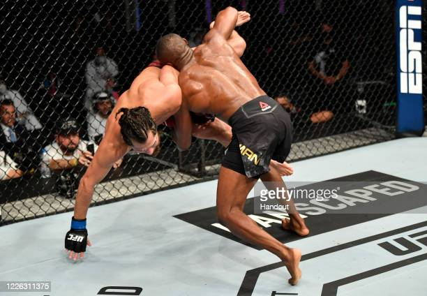 In this handout image provided by UFC Kamaru Usman of Nigeria takes down Jorge Masvidal in their UFC welterweight championship fight during the UFC...