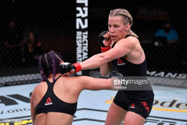 In this handout image provided by UFC, Katlyn Chookagian punches Cynthia Calvillo in their women's flyweight bout during the UFC 255 event at UFC...