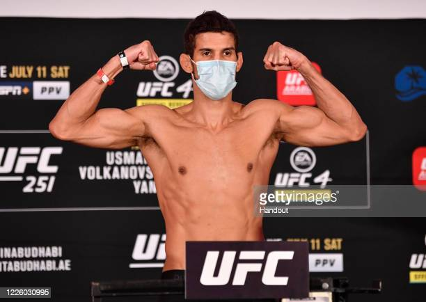 In this handout image provided by UFC, Leonardo Santos of Brazil poses on the scale during the UFC 251 official weigh-in inside Flash Forum at UFC...