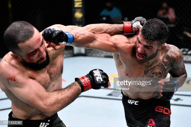 In this handout image provided by UFC Lyman Good punches Belal Muhammad in their welterweight bout during the UFC Fight Night event at UFC APEX on...