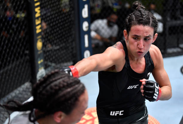 In this handout image provided by UFC, Marina Rodriguez of Brazil punches Michelle Waterson in a flyweight fight during the UFC Fight Night event at...