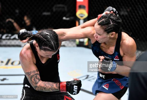 In this handout image provided by UFC Marion Reneau and Raquel Pennington trade punches in their bantamweight bout during the UFC Fight Night event...