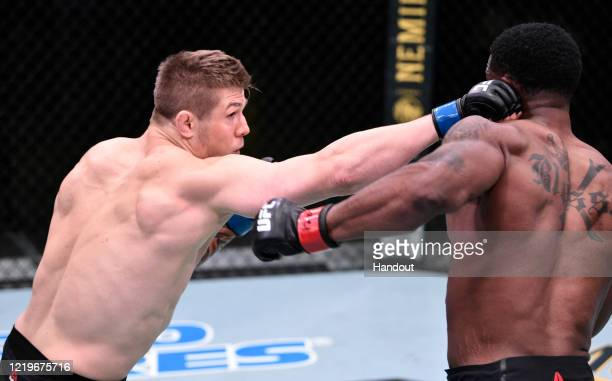 In this handout image provided by UFC Marvin Vettori of Italy punches Karl Roberson in their middleweight fight during the UFC Fight Night event at...