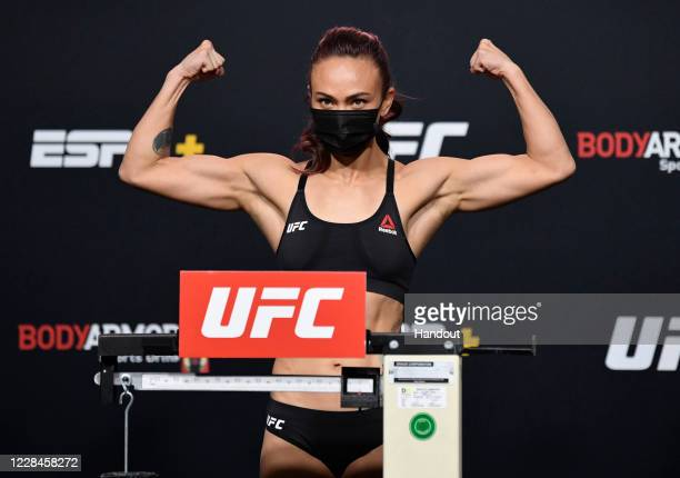 In this handout image provided by UFC, Michelle Waterson poses on the scale during the UFC Fight Night weigh-in at UFC APEX on September 11, 2020 in...
