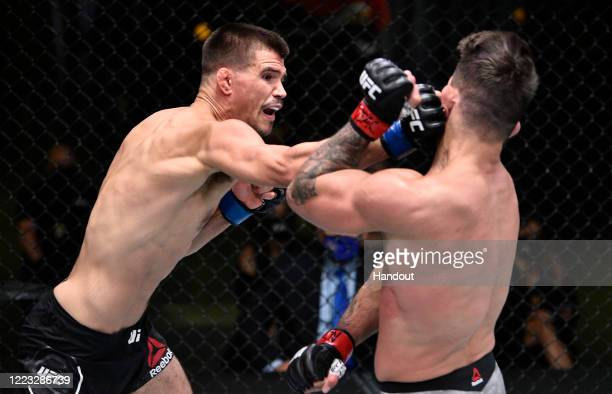 In this handout image provided by UFC Mickey Gall punches Mike Perry in their welterweight fight during the UFC Fight Night event at UFC APEX on June...