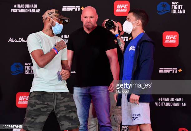 In this handout image provided by UFC Opponents Deiveson Figueiredo of Brazil and Joseph Benavidez face off during the UFC Fight Night weighin inside...