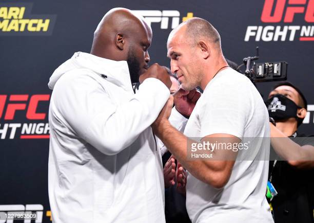 In this handout image provided by UFC, Opponents Derrick Lewis and Aleksei Oleinik of Russia face off during the UFC Fight Night weigh-in at UFC APEX...
