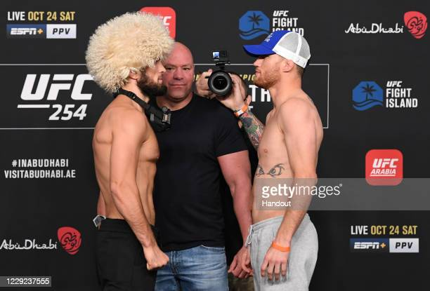 In this handout image provided by UFC, Opponents Khabib Nurmagomedov of Russia and Justin Gaethje face off during the UFC 254 weigh-in on October 23,...