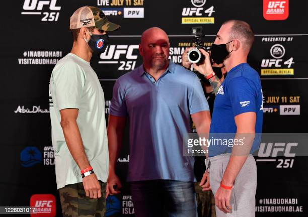 In this handout image provided by UFC, Opponents Leonardo Santos of Brazil and Roman Bogatov of Russia face off during the UFC 251 official weigh-in...