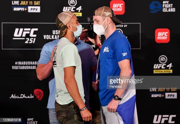 In this handout image provided by UFC, Opponents Makwan Amirkhani of Finland and Danny Henry of Scotland face off during the UFC 251 official...