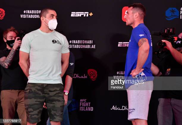 In this handout image provided by UFC Opponents Robert Whittaker of New Zealand and Darren Till of England face off during the UFC Fight Night...