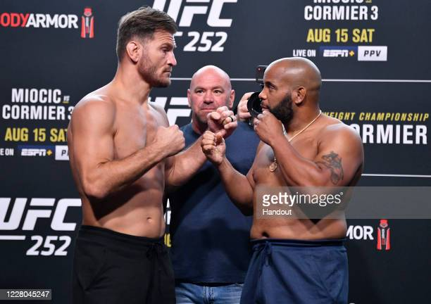In this handout image provided by UFC, Opponents Stipe Miocic and Daniel Cormier face off during the UFC 252 weigh-in at UFC APEX on August 14, 2020...