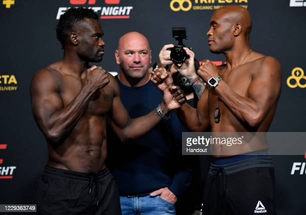 In this handout image provided by UFC, Opponents Uriah Hall of Jamaica and Anderson Silva of Brazil face off during the UFC Fight Night weigh-in at...