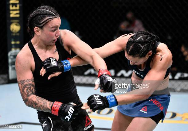 In this handout image provided by UFC Raquel Pennington punches Marion Reneau in their bantamweight bout during the UFC Fight Night event at UFC APEX...