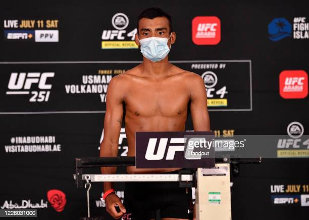 In this handout image provided by UFC, Raulian Paiva of Brazil poses on the scale during the UFC 251 official weigh-in inside Flash Forum at UFC...