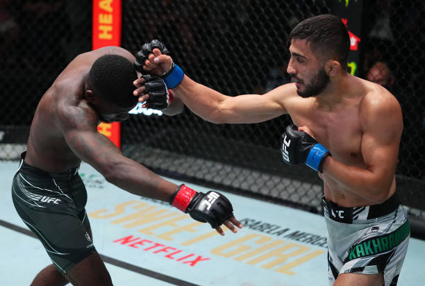 In this handout image provided by UFC, Saidyokub Kakhramonov of Uzbekistan punches Trevin Jones of Guam in a bantamweight fight during the UFC Fight...