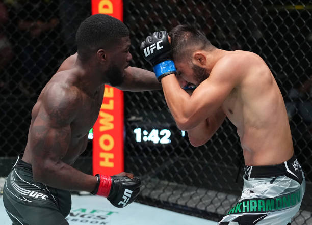 In this handout image provided by UFC, Trevin Jones of Guam punches Saidyokub Kakhramonov of Uzbekistan in a bantamweight fight during the UFC Fight...