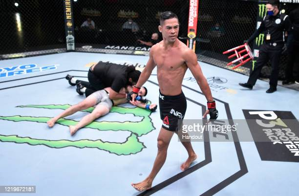 In this handout image provided by UFC, Tyson Nam reacts after his knockout victory over Zarrukh Adashev of Uzbekistan in their bantamweight fight...
