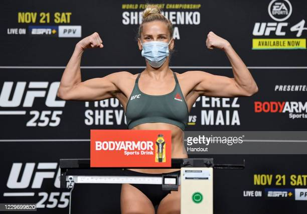 In this handout image provided by UFC,Katlyn Chookagian poses on the scale during the UFC 255 weigh-in at UFC APEX on November 20, 2020 in Las Vegas,...
