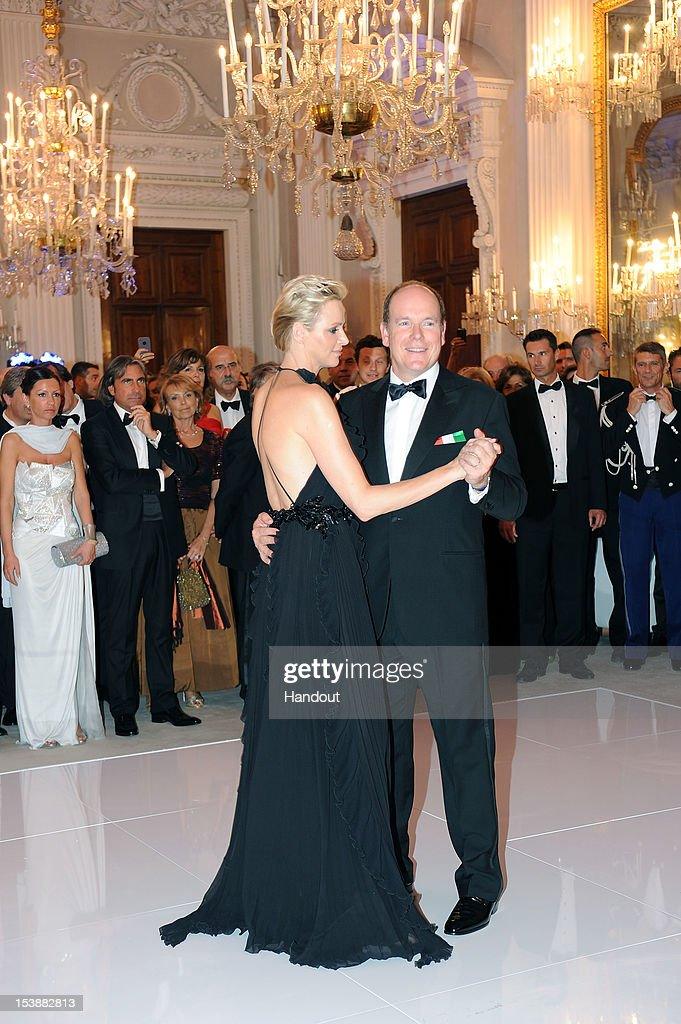 In this handout image provided by Ufficio Stampa Ballo del Giglio, Prince Albert of Monaco and princess Charlene of Monaco attend the 2012 Ballo del Giglio at Palazzo Pitti on October 10, 2012 in Florence, Italy.