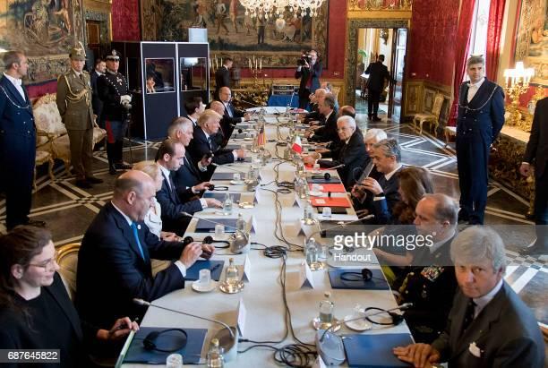 In this handout image provided by Ufficio Stampa e Comunicazione della Presidenza della Repubblica US President Donald Trump and Italian President...