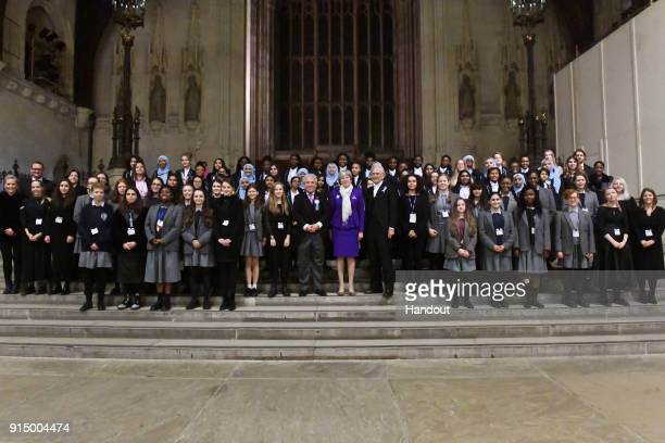 In this handout image provided by UK Parliament British Prime Minister Theresa May poses with Speaker of the House of Commons John Bercow and guests...