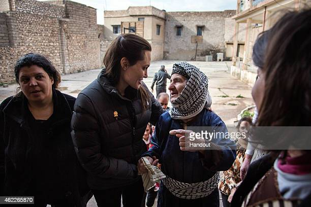 In this handout image provided by UNHCR, UNHCR Special Envoy Angelina Jolie meets meets displaced Iraqis who are members of the minority Christian...
