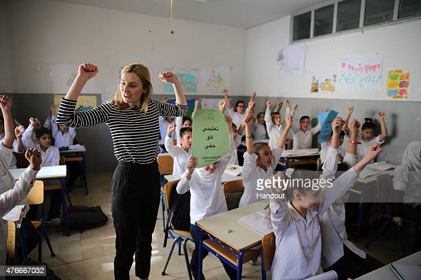 In this handout image provided by UNICEF 'A World at School' Ambassador Laura Carmichael visits refugee children at school in the Bekaa Valley which...