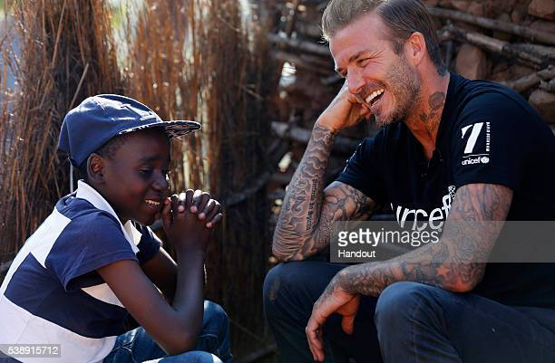 In this handout image provided by UNICEF UNICEF Goodwill Ambassador David Beckham meets Sebenelle in Makhewu Swaziland on June 7 who receives the 7...