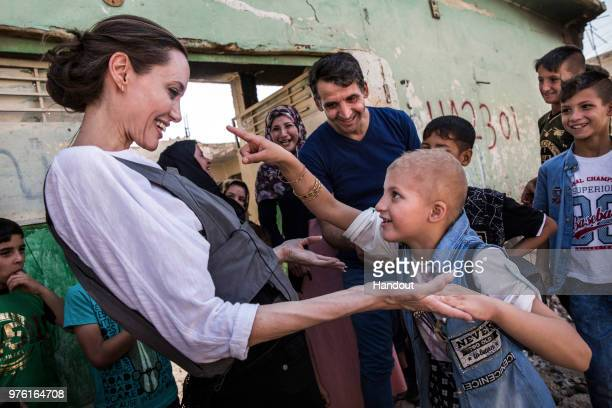 In this handout image provided by United Nations High Commission for Refugees UNHCR Special Envoy Angelina Jolie meets Falak during a visit to West...