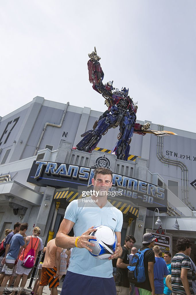 In this handout image provided by Universal Orlando, player of the year and Tottenham Hotspur player Gareth Bale is making the most of his end of season break with a day at Universal Orlando Resort on June 11, 2013 in Orlando, Florida. Gareth and his childhood friends enjoyed a kick about in front of Universal Studios Florida's newest attraction,