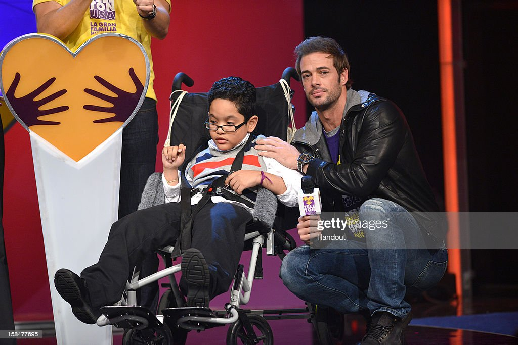 In this handout image provided by Univision Network, William Levy (R) participates in TeletonUSA, the first-ever 28-hour fundraising event to benefit children with disabilities, cancer, and autism in the United States broadcast on Univision Network on December 15, 2012 in Miami, Florida.
