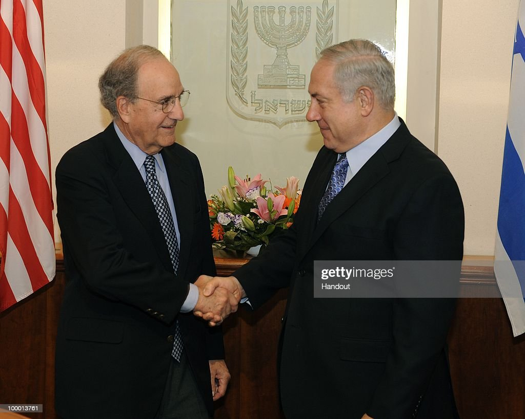 In this handout image provided by U.S. Embassy Tel Aviv, US Special Envoy George Mitchell (L) shakes hands with Israeli Prime Minister Binyamin Netanyahu as they meet at the Prime Minister's office on May 20, 2010 in Tel Aviv, Israel. Special envoy Mitchell has initiated a new round of middle east talks, mediating between the Israelis and Palestinian National Authority, while both parties refuse to hold direct talks.
