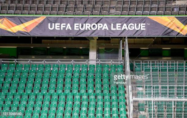 In this handout image provided by VfL Wolfsburg Empty seats are seen inside the stadium prior to the UEFA Europa League round of 16 first leg match...