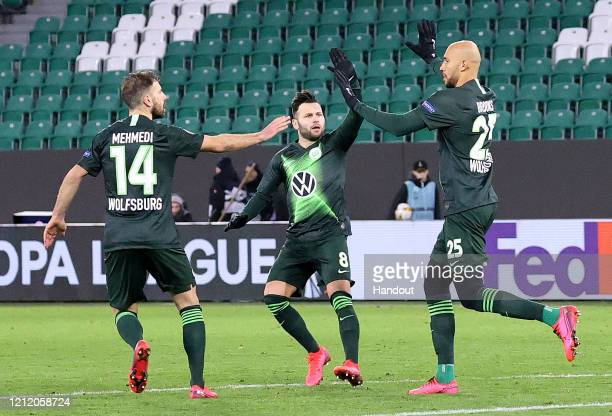 In this handout image provided by VfL Wolfsburg, John Anthony Brooks of VfL Wolfsburg celebrates after scoring his team's first goal with Renato...