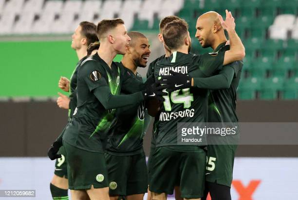 In this handout image provided by VfL Wolfsburg, John Anthony Brooks of VfL Wolfsburg celebrates with his team mates after scoring his team's first...