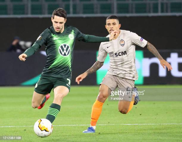 In this handout image provided by VfL Wolfsburg, Josip Brekalo of VfL Wolfsburg is challenged by Dodo of Shakhtar Donetsk during the UEFA Europa...