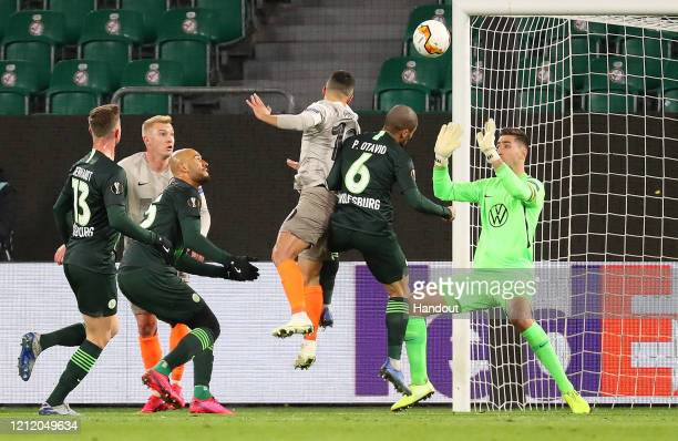 In this handout image provided by VfL Wolfsburg, Junior Moraes of Shakhtar Donetsk scores his team's first goal during the UEFA Europa League round...