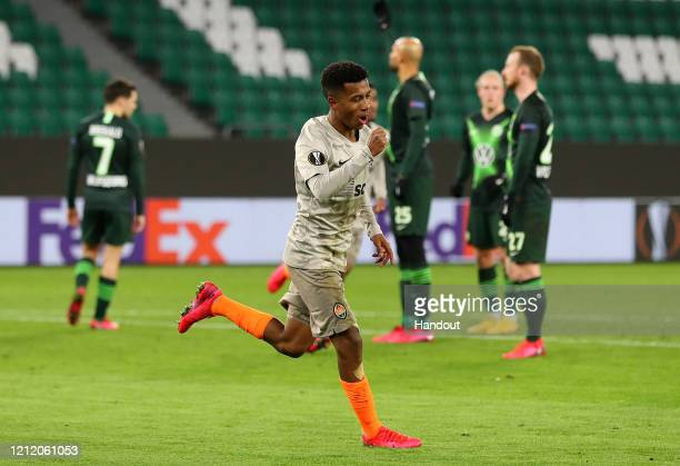 In this handout image provided by VfL Wolfsburg, Marcos Antonio of Shakhtar Donetsk celebrates after scoring his team's second goal during the UEFA...
