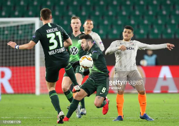 In this handout image provided by VfL Wolfsburg, Renato Steffen of VfL Wolfsburg is challenged by Dodo of Shakhtar Donetsk during the UEFA Europa...