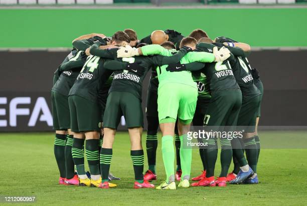 In this handout image provided by VfL Wolfsburg, The VfL Wolfsburg team create a huddle prior to the UEFA Europa League round of 16 first leg match...