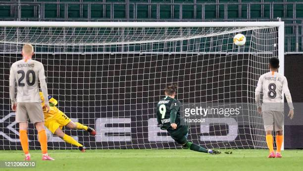 In this handout image provided by VfL Wolfsburg, Wout Weghorst of VfL Wolfsburg misses a penalty during the UEFA Europa League round of 16 first leg...