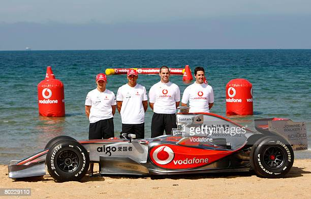 In this handout image provided by Vodafone Heikki Kovalainen of Finland and Lewis Hamilton of Great Britain and Vodafone McLaren Mercedes team poses...