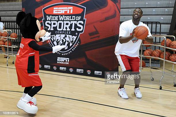 In this handout image provided by Walt Disney Studios Miami Heat guard Dwyane Wade prepares to take a threepoint shot as he is guarded by Mickey...